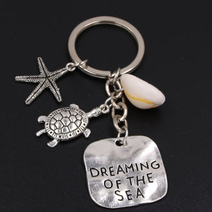'Dreaming Of The Sea'  Key Ring In Antique Silver Plate With Sea Turtle Starfish And Lovely Little Conch Shell!