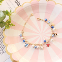 Load image into Gallery viewer, 'Fairy Tale Fancy' Adorned With Shells & Fish & Starfish And Simulated Pearls Charm Bracelet!