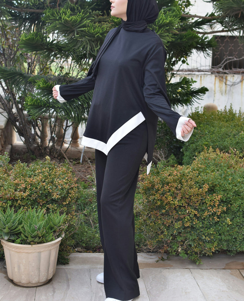 Black winter training suit designed with special white wide stripes exxab.com