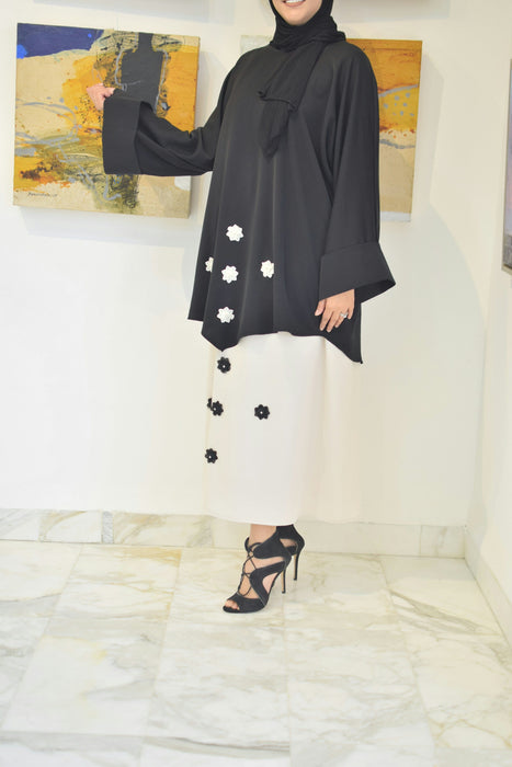 Elegant black top with offwhite skirt designed with small flowers exxab.com