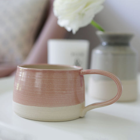 The Handmade mug from Claire Folkes Ceramics in a pink glaze