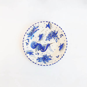 Mid-century plate with blue hand-painted decoration