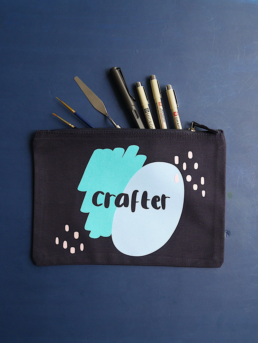Grizzli Bear navy large zip pouch with crafter printed in blue flock, with paint brushes and pens