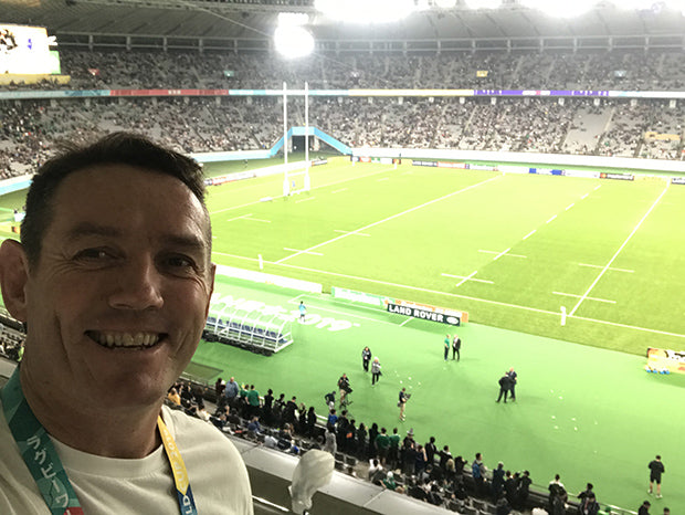 Jim juggles fatherhood with the 4-hour time difference at the Rugby World Cup.