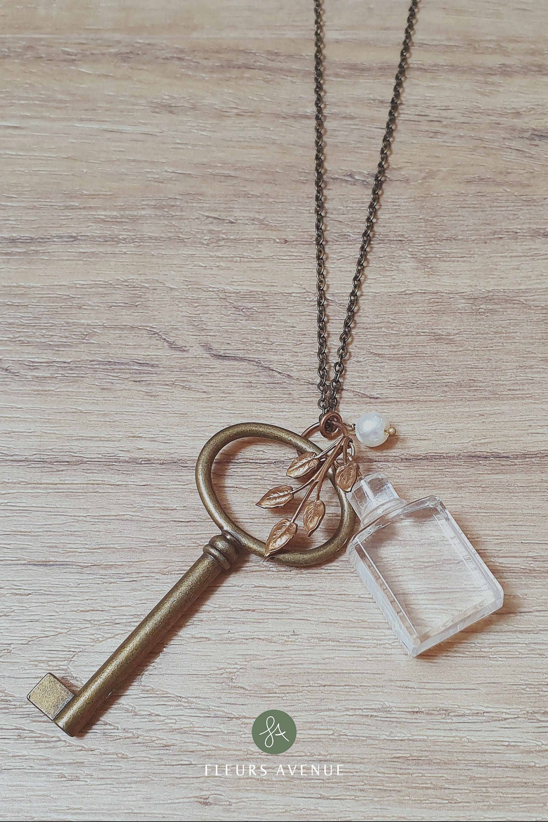 nature inspired alice's in wonderland skeleton key necklace drink me bottle.
