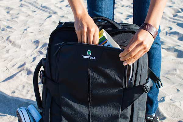 Quick access pocket on travel backpack