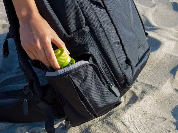 Side water bottle pocket on travel backpack