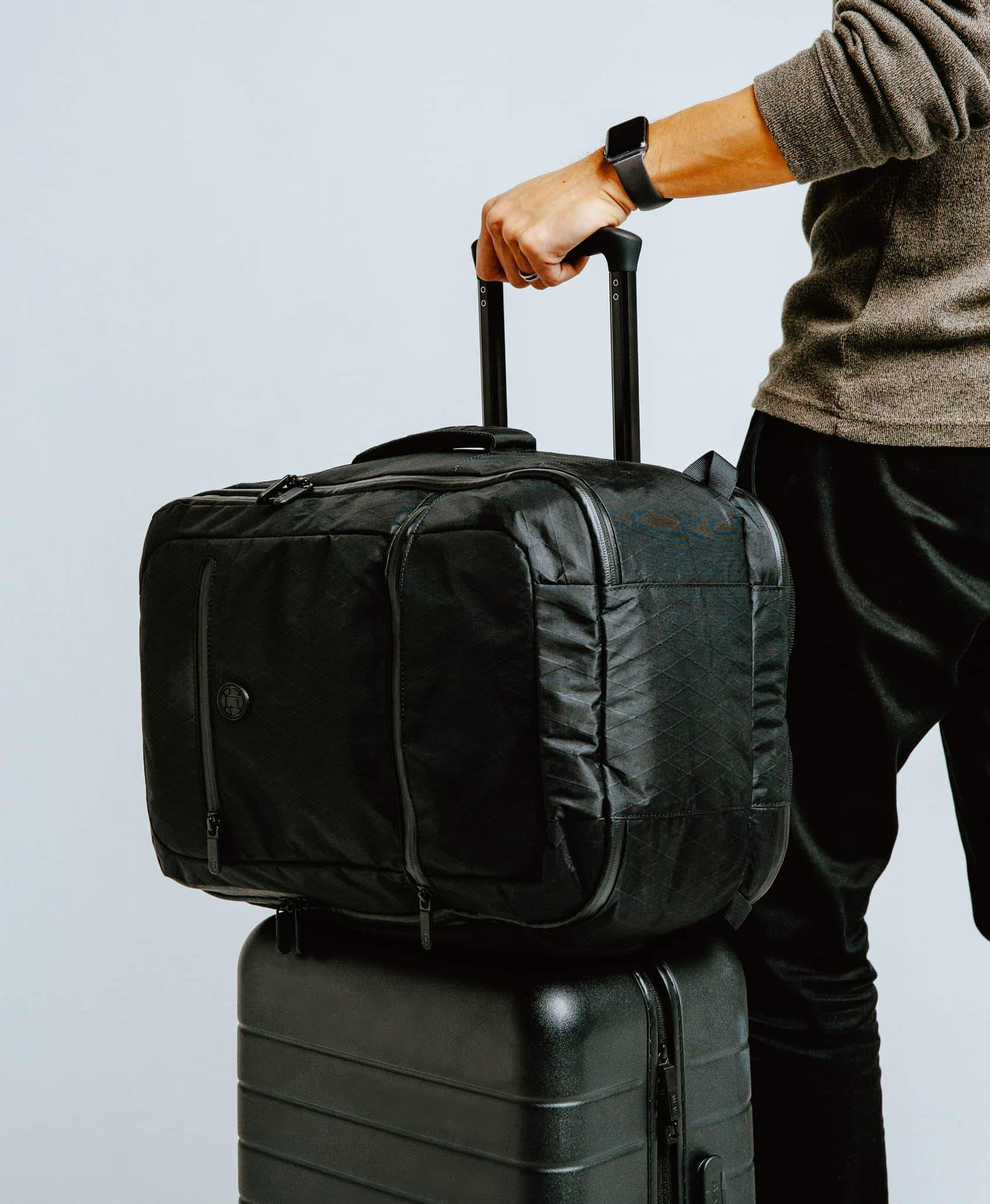 product/ Passthrough sleeve pairs with a rolling suitcase