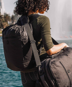 product/ Carry your backpack and daypack at the same time
