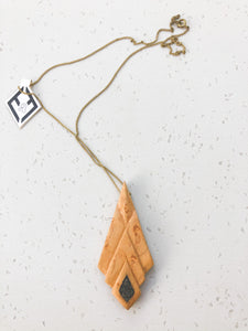 Hand carved bird's eye maple pendant with inlay