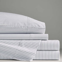 "Charcoal grey and white pinstripes run horizontally on one side and vertically on the other—chic and modern no matter how you flip it. Extra soft stonewashed cotton percale for the ultimate sleeping, snoozing, stretching, ""I woke up like this"" experience."