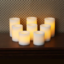 Candle Impressions Set of 8 Patented Faux Wick Cream Wax Battery Operated Flameless Pillar Candles with Auto Timer Option - Assorted Sizes