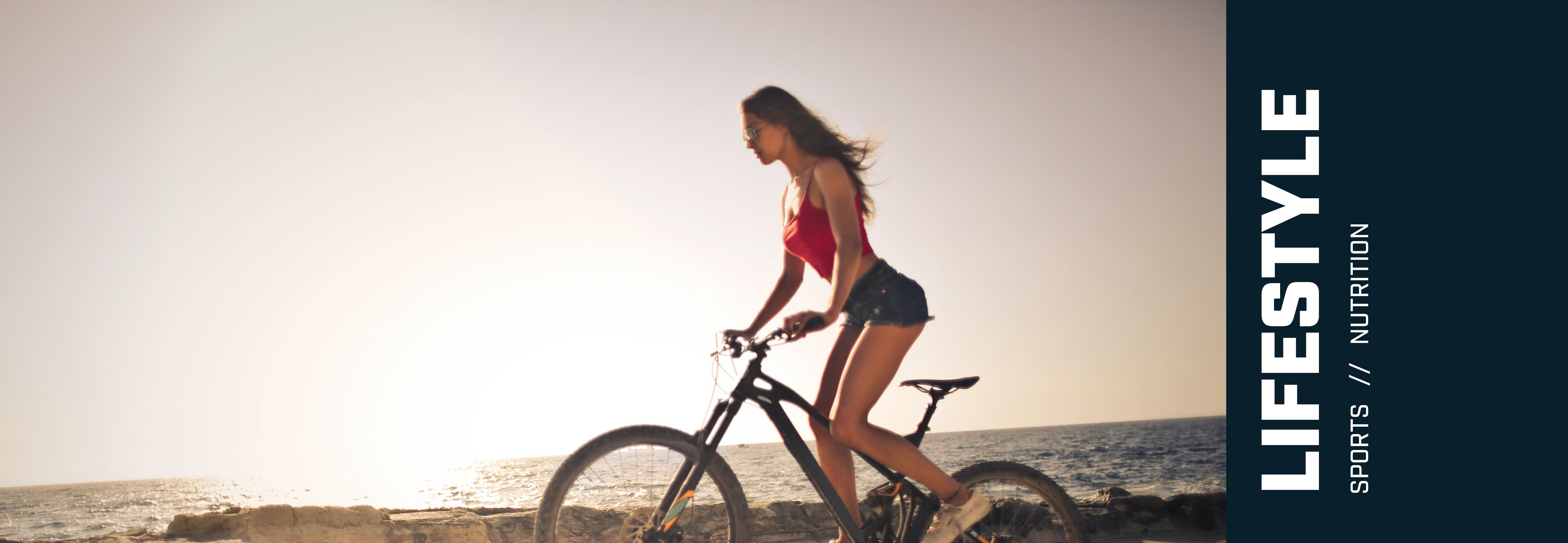 Woman cycling on the beach. Sports, lifestyle, nutrition.
