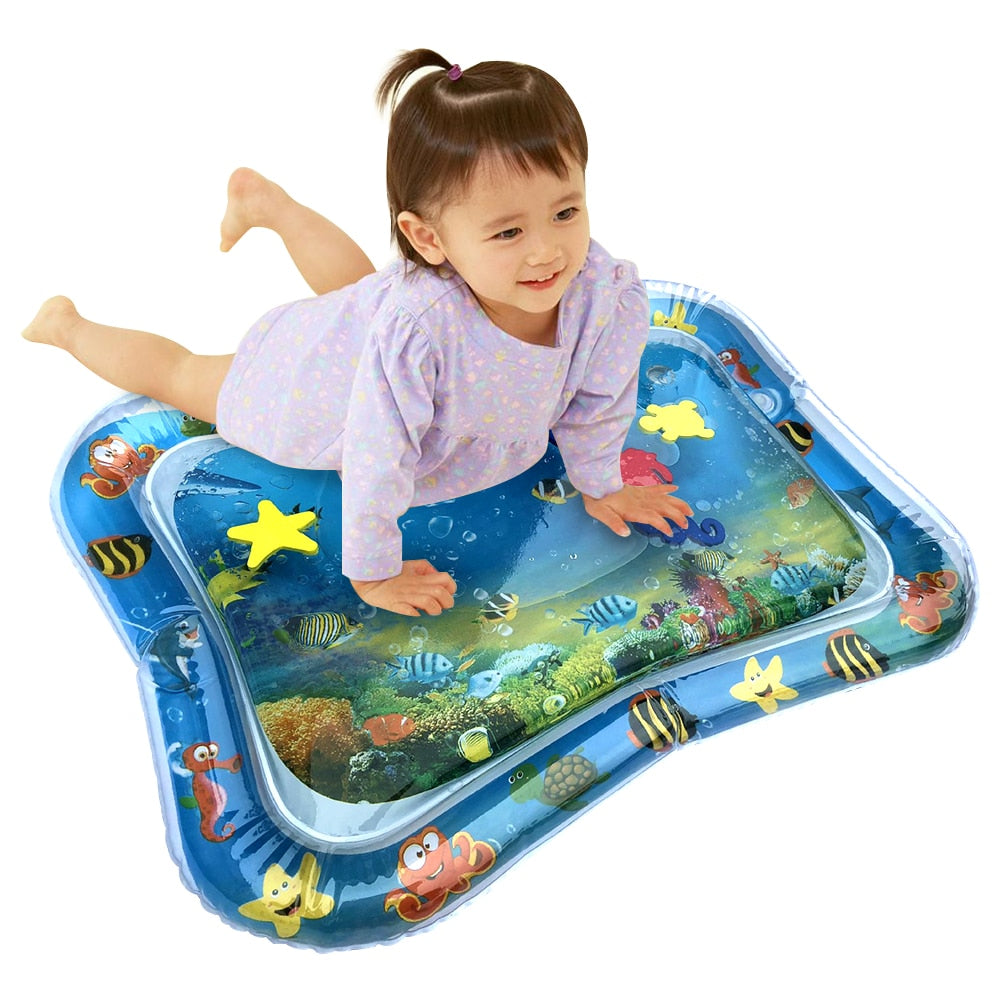 Baby girl on inflatable mat