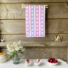100% cotton eco-friendly tea towel / kitchen towel with cute hand drawn anchor and stripe pattern on a rustic white table
