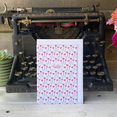 blank-inside hello card featuring a simple red tulips with blue stems pattern
