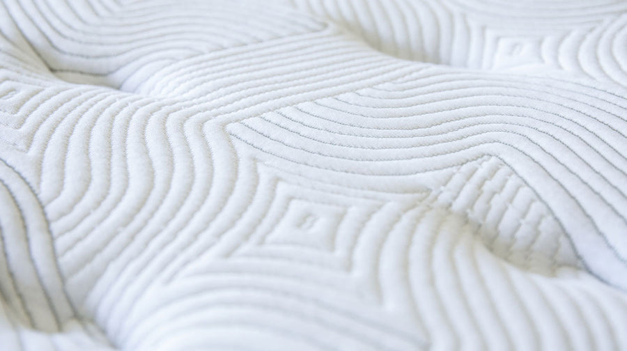 Current Mattress - Up close photo of mattress pillowing and pattern