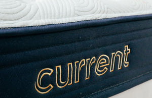 Current Mattress - Up close shot of Current logo stitched into mattress side