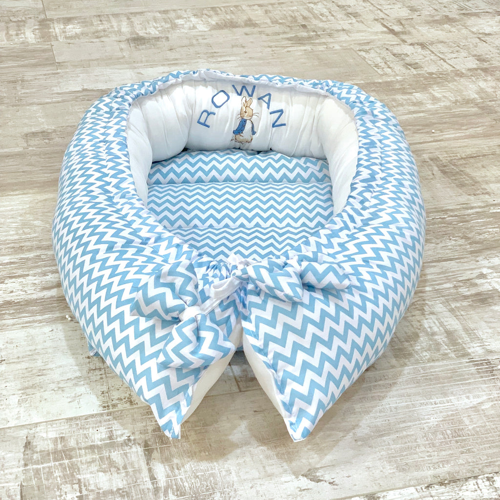 Personalised Blue Zigzag And White Peter Rabbit Baby Sleep Nest Pod