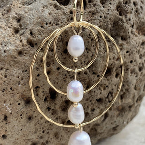 Four pearl triple hoop earring  showing the hoops and pearls.