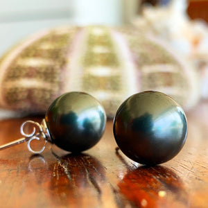 Black 12mm shell pearls with sterling silver posts.