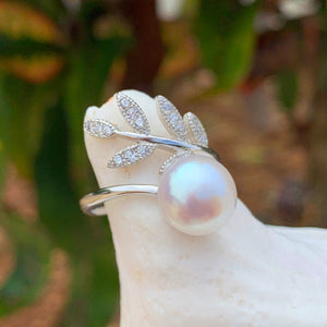 Close up of adjustable Maile Cubic zirconia ring with white pearl made with sterling silver.