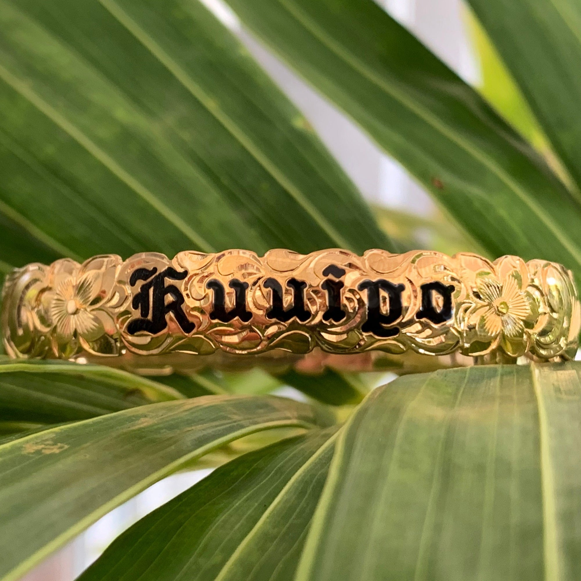 Custom 10mm Bracelet with black enamel lettering and scallop edge design.