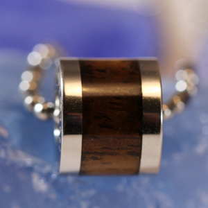Koa Barrel Stainless Steel Pendant closeup