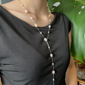 "Dew drop freshwater pearl necklace with 36"" chain length on model."