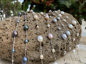 "Dew drop freshwater pearl necklace with 36"" chain length in four different colors."