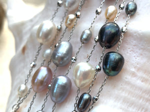 "Close up of Dew drop freshwater pearl necklaces with 36"" chain length."