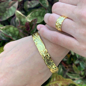 14K Gold Plated Hawaiian Scroll Bangle - 10mm on model with matching ring