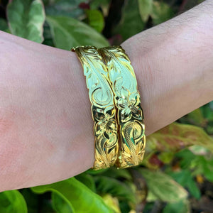 14K Gold Plated Hawaiian Scroll Bangle - 10mm on Model two bracelets