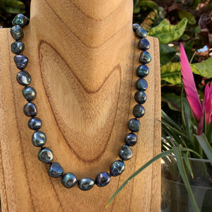 Baroque pearl necklace on display shown in black.