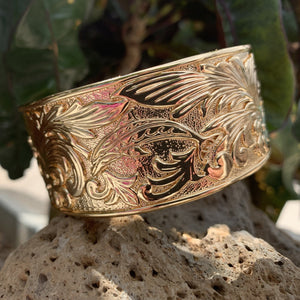 Under the sea bangle showing closeup of dolphin