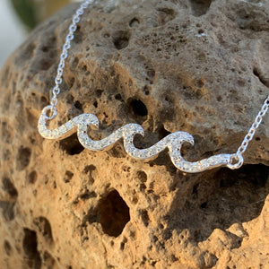 Crystal wave pave pendant in white caps.