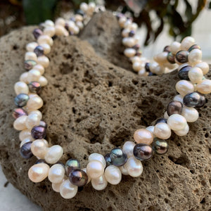 Cluster pearl necklace in mixed colors with black and white pearls.