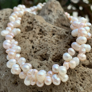 Cluster pearl necklace in solid whites and light pink pearls.