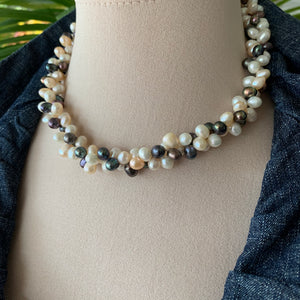 Mixed cluster pearl necklace in black and white pearls on model.