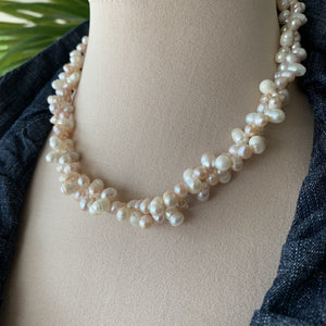Solid cluster pearl necklace in white and light pink pearls.