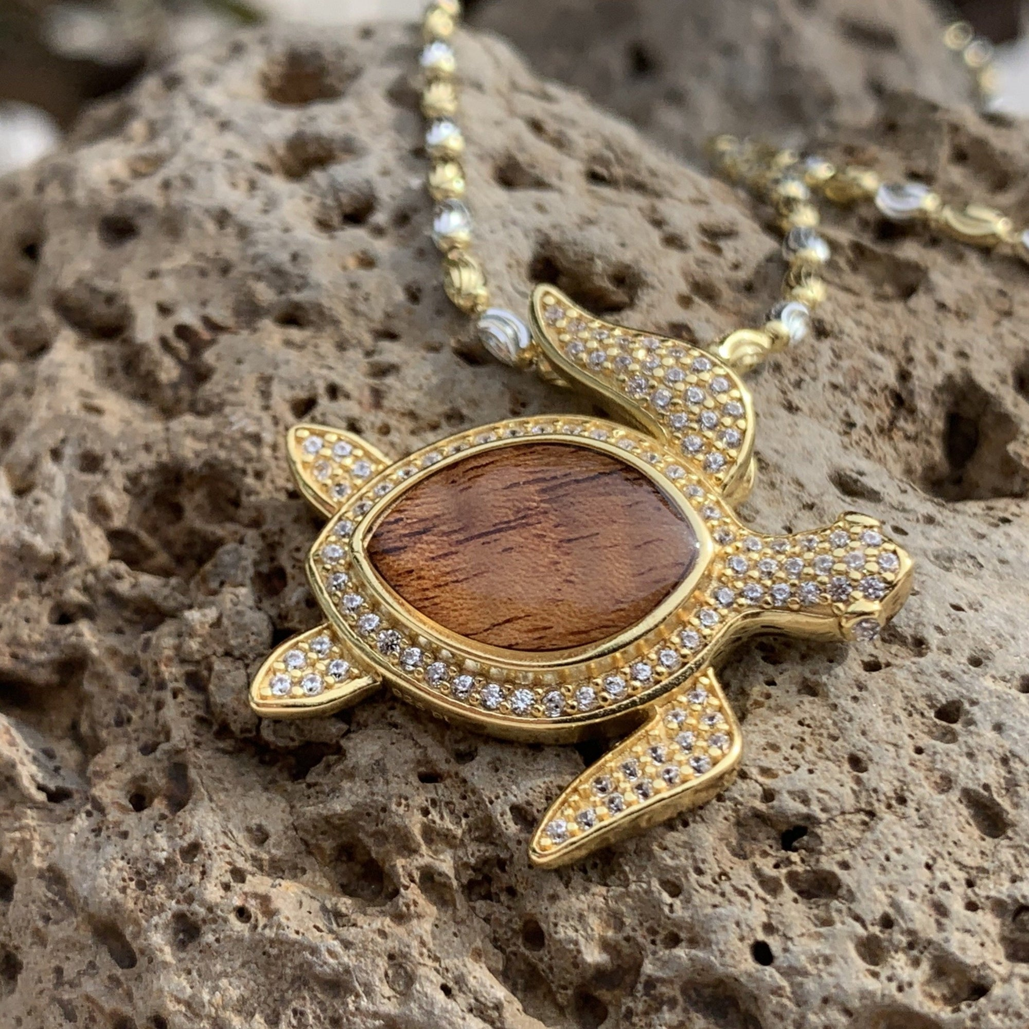 Koa cubic zirconia pave turtle in 14K gold plating over sterling silver.