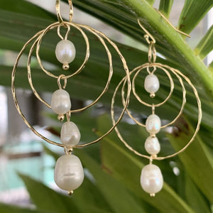 Four freshwater pearls on a triple hoop earring with gold plated sterling silver posts.