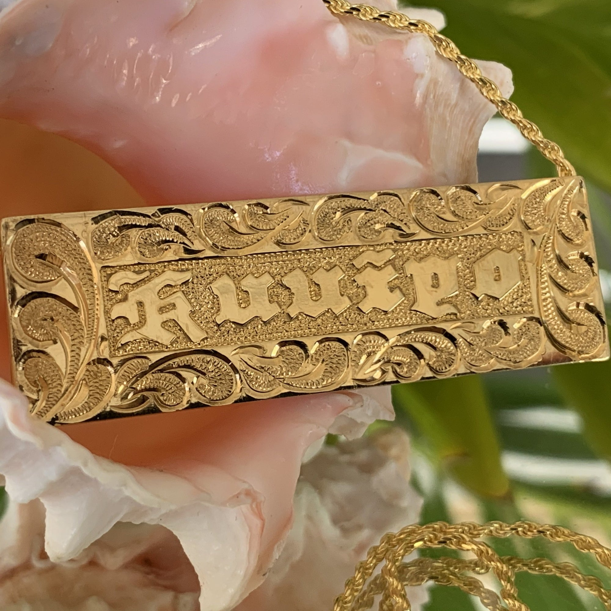 Close up of Nameplate with detailing and hand engraving.