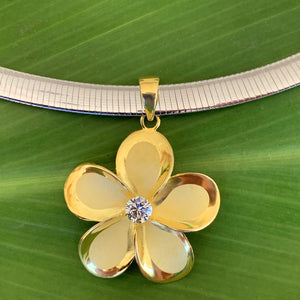 Close up of Omega Chain & Plumeria Pendant with the reverse silver side of Omega chain showing how you can wear it with the gold or silver side showing.