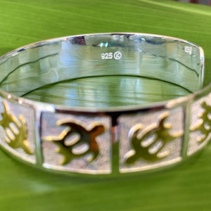 Close up of petroglyph honu cuff with .925 Sterling Silver stamp on the inside of the cuff.