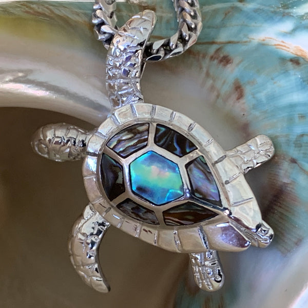 Close up of Sterling Silver Turtle showing the details and colors of the mother of pearl set in pendant.