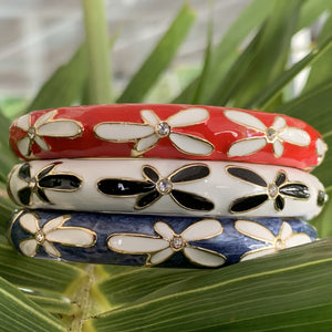 Plumeria Bracelet with Cubic Zirconia showing red, white and blue colors.