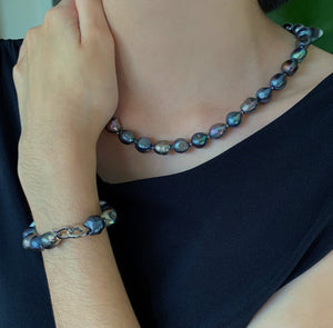 Baroque pearl necklaces shown in black on model along with bracelet.