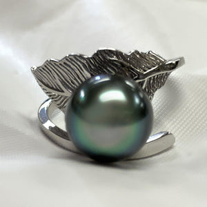 Close up of Tahitian pearl adjustable ring with leaf detailing.