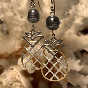 Close up of black tri color earrings together side by side.